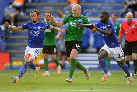 James Maddison (L) and Nampalys Mendy of Leicester City in action against Aaron Mooy (C) of Brighton during the English Premier League match between Leicester City and Brighton in Leicester, Britain, 23 June 2020.