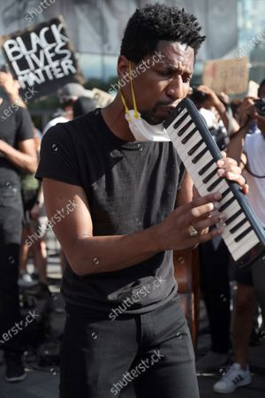 Editorial photo of Black Lives Matter rally outside the Barclays Center in Brooklyn, New York, USA - 12 Jun 2020