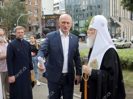 Stock Picture of Honorary Patriarch Filaret (R) and Merited Doctor of Ukraine Oleh Shekera attend the ceremony to lay the symbolic first brick of the monument honouring healthcare workers, Kyiv, capital of Ukraine.