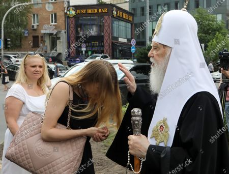 Honorary Patriarch Filaret blesses a woman during the ceremony to lay the symbolic first brick of the monument honouring healthcare workers, Kyiv, capital of Ukraine.