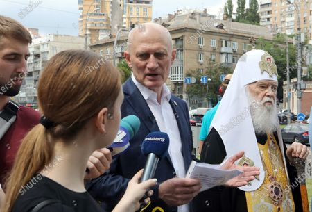 Stock Image of Honorary Patriarch Filaret (R) and Merited Doctor of Ukraine Oleh Shekera face the press during the ceremony to lay the symbolic first brick of the monument honouring healthcare workers, Kyiv, capital of Ukraine.