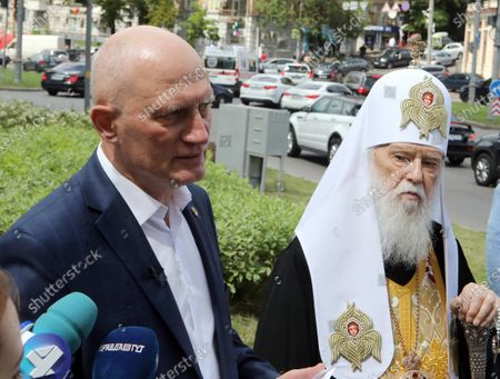 Stock Photo of Honorary Patriarch Filaret (R) and Merited Doctor of Ukraine Oleh Shekera face the press during the ceremony to lay the symbolic first brick of the monument honouring healthcare workers, Kyiv, capital of Ukraine.