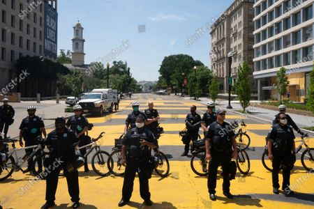 Police block Black Lives Matter Plaza near the White House in Washington D.C., U.S., as crews clean the area. Trump tweeted that he authorized the Federal government to arrest any demonstrator caught vandalizing U.S. monuments, with a punishment of up to 10 years in prison.