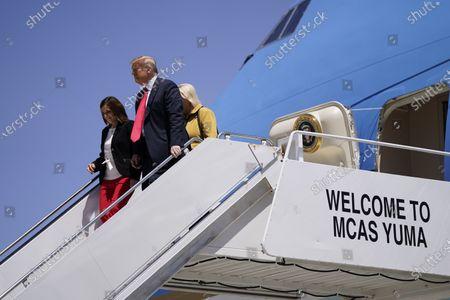 President Donald Trump departs from Air Force One with Sen. Martha McSally, R-Ariz., left, and Rep. Debbie Lesko, R-Ariz., at Marine Corps Air Station Yuma, Ariz