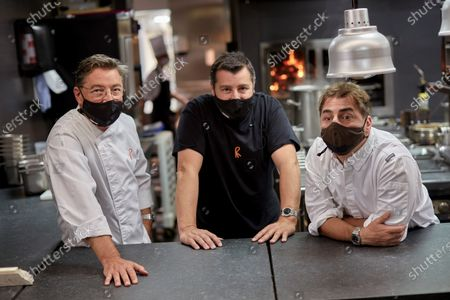 Stock Image of (L-R) Spanish chefs Joan Roca, Josep Roca and Jordi Roca pose for the photographer in the kitchen of their 'El Celler de Can Roca' restaurant in Girona, Catalonia, Spain, 23 June 2020. 'El Celler de Can Roca' is the first Spanish Michelin 3-stars restaurant to reopen his doors as the state of emergency is lifted after a prolonged lockdown period due to the ongoing pandemic of the COVID-19 disease caused by the SARS-CoV-2 coronavirus.