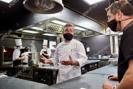 Spanish chef Joan Roca (C) works in the kitchen of the 'El Celler de Can Roca' restaurant in Girona, Catalonia, Spain, 23 June 2020. 'El Celler de Can Roca' is the first Spanish Michelin 3-stars restaurant to reopen his doors as the state of emergency is lifted after a prolonged lockdown period due to the ongoing pandemic of the COVID-19 disease caused by the SARS-CoV-2 coronavirus.