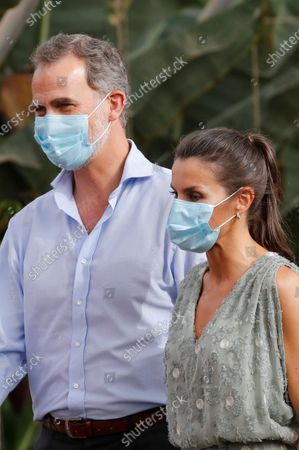 Stock Image of King Felipe VI (L) and Queen Letizia (R) of Spain, wearing face masks and accompanied by entrepreneurs from the tourism and agricultural sectors, visits Granadilla de Abona, in Tenerife, Canary Islands, Spain, 23 June 2020. The Spanish Royal couple started their tour on the Canary Islands before visiting the rest of the country after the Covid-19 coronavirus lockdown was lifted.