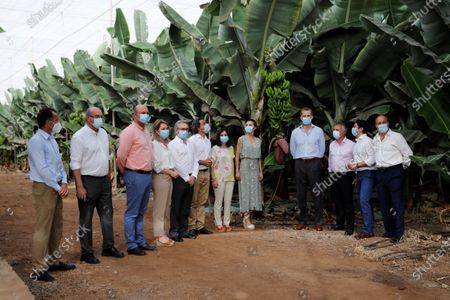 King Felipe VI (4-R) and Queen Letizia (5-R) of Spain, wearing face masks and accompanied by entrepreneurs from the tourism and agricultural sectors, visits Granadilla de Abona, in Tenerife, Canary Islands, Spain, 23 June 2020. The Spanish Royal couple started their tour on the Canary Islands before visiting the rest of the country after the Covid-19 coronavirus lockdown was lifted.