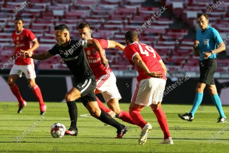 Santa Clara's Osama Rashid (2-L) in action against Benfica players Adel Taarabt (2-R) and Gabriel (C) during the Portuguese First League soccer match between Benfica Lisbon and Santa Clara at Luz stadium in Lisbon, Portugal, 23 June 2020.