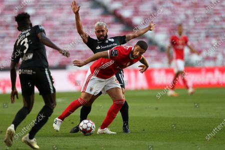Stock Image of Benfica's Adel Taarabt (R) in action against Santa Clara's Anderson Carvalho (C) during the Portuguese First League soccer match between Benfica Lisbon and Santa Clara at Luz stadium in Lisbon, Portugal, 23 June 2020.