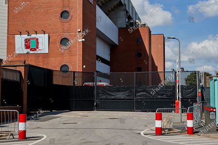 A general view of black plastic attached to the fences and gates of the car park next to the Sir Kenny Dalglish stand at Anfield prior to the return of the Premier League at Anfield when Liverpool host Crystal Palace