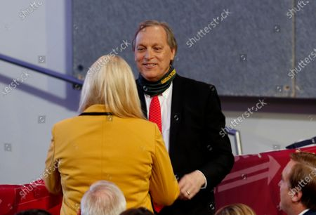Rep. Andy Biggs, R-Ariz., right, and Rep. Debbie Lesko, R-Ariz., left, talk before President Donald Trump speaks at the Students for Trump conference at Dream City Church, in Phoenix