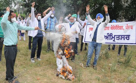 Members of Punjab Rural Health Pharmacy Officers Association raise slogans during a protest against the state government and Punjab Rural Development and Panchayats minister Tript Rajinder Singh Bajwa demanding regularization of their jobs, outside Deputy Commissioner Office, on June 23, 2020 in Amritsar, India.
