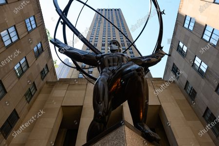 The 'Atlas' statue by Lee Lawrie and Rene Paul Chambellan wears a saftey mask in New York. New York State Governor Andrew Cuomo announced that New York has entered Phase 2 of re-opening which eases business restrictions amid the coronavirus pandemic.