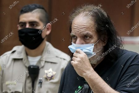 Adult film actor Ron Jeremy (R) attends his arraignment at Clara Shortridge Foltz Criminal Justice Center in Los Angeles, California, USA, 23 June 2020. He is facing charges of raping three women and sexually assaulting another in separate incidents dating back to 2014.