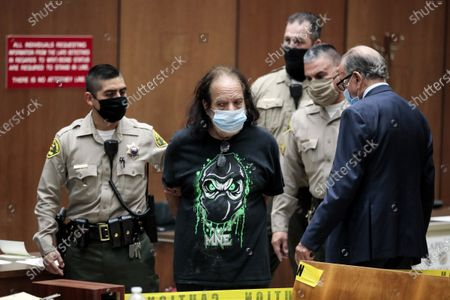 Adult film actor Ron Jeremy (C) is charged with sexually assaulting four women during his arraignment at Clara Shortridge Foltz Criminal Justice Center in Los Angeles, California, USA, 23 June 2020. He is facing charges of raping three women and sexually assaulting another in separate incidents dating back to 2014.