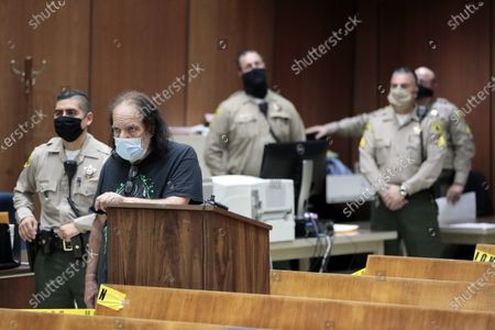 Adult film star Ron Jeremy (2-L) appears during his arraignment at Clara Shortridge Foltz Criminal Justice Center in Los Angeles, California, USA, 23 June 2020. He is facing charges of raping three women and sexually assaulting another in separate incidents dating back to 2014.