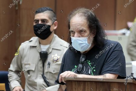 Adult film star Ron Jeremy (R) appears during his arraignment at Clara Shortridge Foltz Criminal Justice Center in Los Angeles, California, USA, 23 June 2020. He is facing charges of raping three women and sexually assaulting another in separate incidents dating back to 2014.