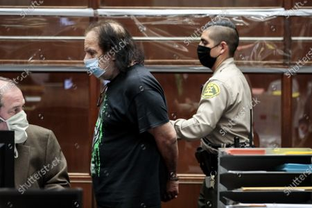 Adult film actor Ron Jeremy (L) leaves after his arraignment at Clara Shortridge Foltz Criminal Justice Center in Los Angeles, California, USA, 23 June 2020. He is facing charges of raping three women and sexually assaulting another in separate incidents dating back to 2014.