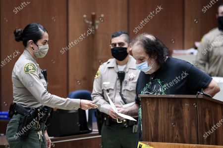 Adult film actor Ron Jeremy (R) appears during his arraignment at Clara Shortridge Foltz Criminal Justice Center in Los Angeles, California, USA, 23 June 2020. He is facing charges of raping three women and sexually assaulting another in separate incidents dating back to 2014.