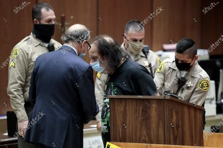 Adult film star Ron Jeremy (3-R) speaks with his attorney Stuart Goldfarb (2-L) during his arraignment at Clara Shortridge Foltz Criminal Justice Center in Los Angeles, California, USA, 23 June 2020. He is facing charges of raping three women and sexually assaulting another in separate incidents dating back to 2014.