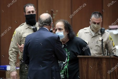 Adult film star Ron Jeremy (2-R) speaks with his attorney Stuart Goldfarb (2-L) during his arraignment at Clara Shortridge Foltz Criminal Justice Center in Los Angeles, California, USA, 23 June 2020. He is facing charges of raping three women and sexually assaulting another in separate incidents dating back to 2014.