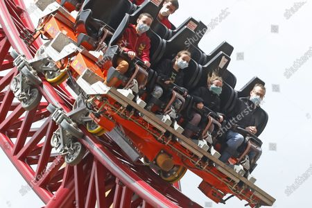In this May 23, 2020, people ride the Cannibal at Lagoon Amusement Park, in Farmington, Utah. Gov. Gary Herbert tweeted, night that he appreciated the analysis by epidemiologist Angela Dunn that outlined the severity of the surge in COVID-19, but made clear he's not considering going backwards with a plan he rolled out in early May that gradually allowed businesses, gyms, salons and pools to reopen