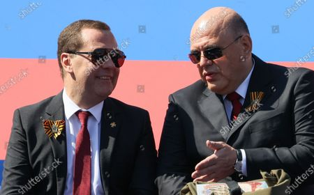 Deputy head of Russia's Security Council Dmitry Medvedev (L)  listens to Russian Prime Minister Mikhail Mishustin (R) before the military parade to commemorate the 75th anniversary of Victory in World War II on Red Square in Moscow, Russia, 24 June 2020.  The military parade marking the 75th anniversary of the victory over Nazi Germany in the World War II takes place in the Red Square on 24 June 2020, as the traditional troops parade as part of the Victory Day Parade which is annually held on 09 May, was cancelled due to Covid-19 epidemic in Russia.