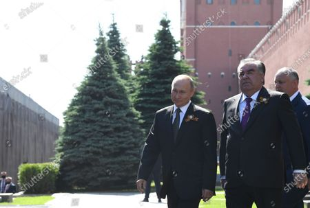 Russian President Vladimir Putin (L)? Tajik President Emomali Rahmon (front R) and Moldovan President Igor Dodon (Back) walk before a military parade in Moscow, Russia, 24 June 2020.  The military parade marking the 75th anniversary of the victory over Nazi Germany in the World War II takes place in the Red Square on 24 June 2020, as the traditional troops parade as part of the Victory Day Parade which is annually held on 09 May, was cancelled due to Covid-19 epidemic in Russia.