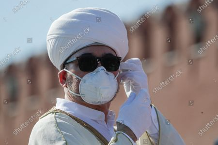 Russia's top Muslim Cleric Ravil Gainutdin fixes his face mask to protect against coronavirus before the military parade marking the 75th anniversary of the Nazi defeat in WWII, in the the Red Square in Moscow, Russia, 24 June 2020. The Victory Day parade normally is held on May 9, the nation's most important secular holiday, but this year it was postponed due to the coronavirus pandemic.