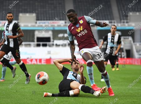 Federico Fernandez of Newcastle United slides in with a challenge on Keinan Davis of Aston Villa