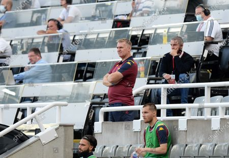 Dean Smith manager of Aston Villa watches the game from the stand