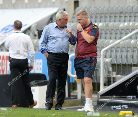 Steve Bruce manager of Newcastle United and Dean Smith manager of Aston Villa