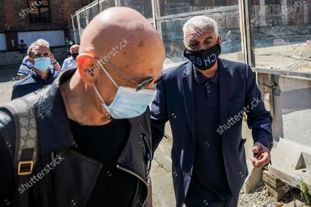 Former football player Evaristo Beccalossi (R) and Italian singer Enrico Ruggeri during the funeral