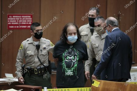 Adult film star Ron Jeremy is charged with sexually assaulting four women in Dept. 30 at LA Superior Court. Attorney Stuart Goldfarb is at right.