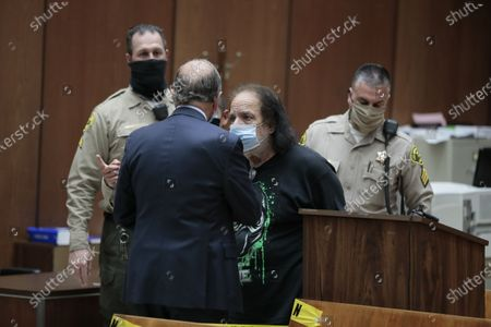 dult film star Ron Jeremy speaks with his attorney Stuart Goldfarb during his appearance in Dept. 30 at LA Superior Court where he is is charged with sexually assaulting four women.