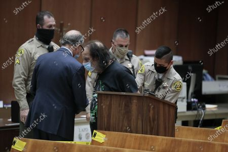 Adult film star Ron Jeremy speaks with his attorney Stuart Goldfarb during his appearance in Dept. 30 at LA Superior Court where he is is charged with sexually assaulting four women.