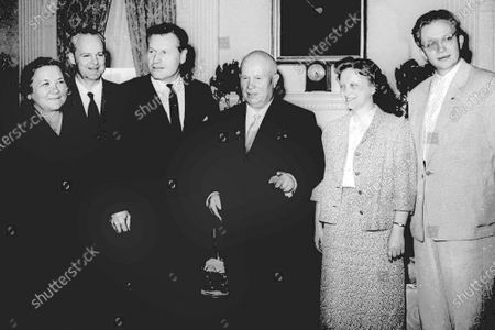 Then-New York Gov. Nelson Rockefeller, third from left, and Soviet Premier Nikita Khrushchev, fourth from left, pose during the governor's visit to the premier's suite in New York's Waldorf-Astoria. From left, are: the premier's wife, Nina, Soviet Ambassador to the U.S. Mikhail Menshikov, Gov. Rockefeller, Rada Adzhubel, the premier's daughter, and Sergei Khrushchev, far right, the premier's son. Sergei Khrushchev died, at his home in Cranston, Rhode Island. He was 84