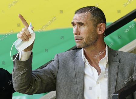 Former player Martin Keown in the stands before the English Premier League soccer match between Norwich City and Everton FC in Norwich, Britain, 24 June 2020.