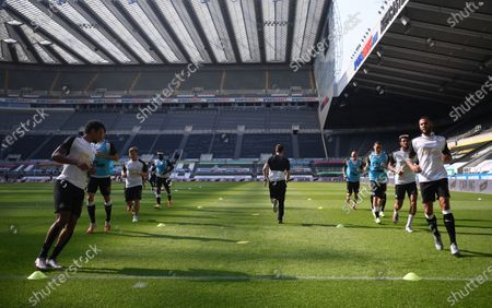 Players of Newcastle warm up before the English Premier League match between Newcastle United and Aston Villa in Newcastle, Britain, 24 June 2020.
