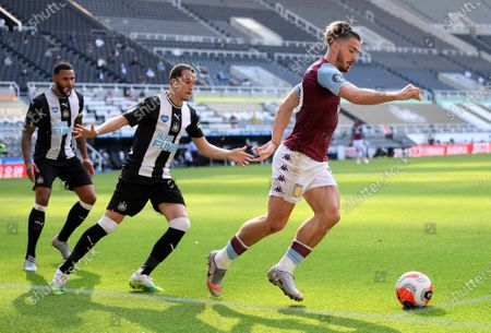 Jack Grealish (R) of Newcastle in action against Javier Manquillo (C) of Aston Villa during the English Premier League match between Newcastle United and Aston Villa in Newcastle, Britain, 24 June 2020.