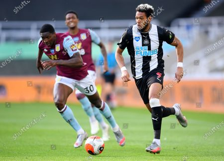 Joelinton (R) of Newcastle in action against Kortney Hause of Aston Villa during the English Premier League match between Newcastle United and Aston Villa in Newcastle, Britain, 24 June 2020.