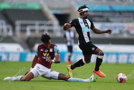 Allan Saint-Maximim (R) of Newcastle in action against Tyrone Mings of Aston Villa during the English Premier League match between Newcastle United and Aston Villa in Newcastle, Britain, 24 June 2020.