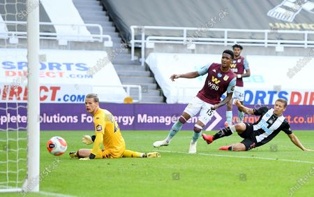 Dwight Gale (R) of Newcastle scores the opening goal during the English Premier League match between Newcastle United and Aston Villa in Newcastle, Britain, 24 June 2020.