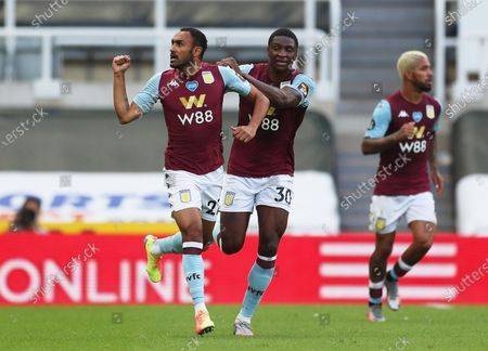 Ahmed El Mohamady (L) of Aston Villa celebrates with teammate Kortney Hause after scoring the 1-1 during the English Premier League match between Newcastle United and Aston Villa in Newcastle, Britain, 24 June 2020.