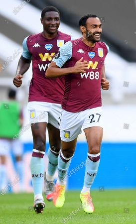 Ahmed El Mohamady (R) of Aston Villa celebrates with teammate Kortney Hause after scoring the 1-1 during the English Premier League match between Newcastle United and Aston Villa in Newcastle, Britain, 24 June 2020.