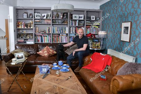 Simon Rimmer 'My Haven'- Living room of his Manchester home 30.1.2018  1.DAD-S WATCH - My dad gave me this when I was about 16. I have always loved the look of it. It was a gift to my dad from his parents on his 21st. 2. FLO-S BOX - I have so many things the kids have made over the years, but there-s something I love about this box above many others. It-s 14 years old and wearing well. 3. LIVERPOOL SHIRT -Signed  4. GIRAFFE Collection - my Mum and Dad have one of these, they-ve had it for years. In my days of collecting bric a brac I found this one in a charity shop for 15p. I-ve got 10 of them now. 5. BLUE DOMINO TEA SET - I still collect the original stuff by T G Green. It-s harder and harder to find. Love the cobalt blue colour and the indented dots. 6. COFFEE MUG - This is possibly the ugliest mug in the world! I bought it from Peets Coffee (set up by the original owner of Starbucks) Filmore St San Francisco. 7.PAULA REGO - When Ali and I were first together, we went to an exhibition and fell in love with her work. Always promised ourselves if we could ever afford a piece we-d buy one. 8. BLOK KNIFE - The guys from Blok Knives were on Sunday Brunch recently and made this knife especially for me. I-ve always wanted a handmade knife and guard it with my life 9. CALIFORNIA PHOTO - Del Mar in San Diego is my happy place. This photo of Ali, the kids and me takes me back there every time I see it 10.SILVER RHINO- Given by the Army 11. COOK BOOK- Graham Kerr 'The Galloping Gourmet' Inspirational Chef that got him into cooking.