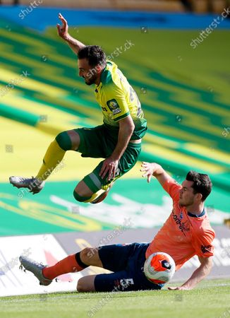 Norwich City's Josip Drmic,top, and Everton's Michael Keane challenge for the ball during the English Premier League soccer match between Norwich and Everton at Carrow Road Stadium in Norwich, England