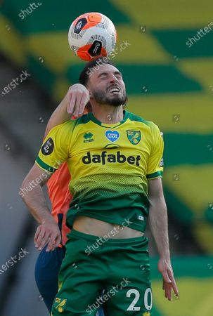 Norwich City's Josip Drmic jumps fro the ball during the English Premier League soccer match between Norwich and Everton at Carrow Road Stadium in Norwich, England