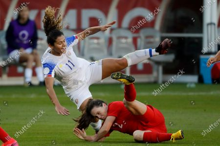 Stock Picture of Costa Rica forward Raquel Rodriguez, top, is knocked over by Canada defender Allysha Chapman during the first half of a CONCACAF women's Olympic qualifying soccer match in Carson, Calif. Raquel Rodriguez, better known as Rocky to her fans, was in route to join her new National Women's Soccer League team when sports were shut down by the coronavirus. It certainly wasn't an ideal start for the Costa Rican striker with the Portland Thorns